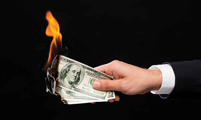 burning-money_wasting-money